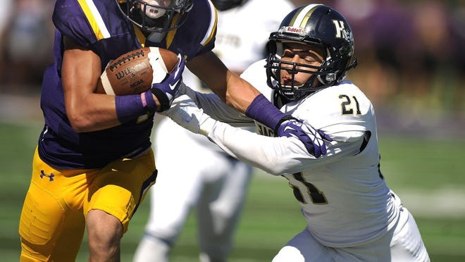 Thomas Metthe/Reporter-News Hardin-Simmons wide receiver Reese Childress (left) shoves away Howard Payne safety Douglas Irby (21) during the second quarter of the Cowboys' 54-15 win on Saturday, Oct. 15, 2016, at HSU's Shelton Stadium.