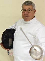 Mike Anderson is one of the fencing teachers at the Knights of the Old Code, a fencing school in Newark.