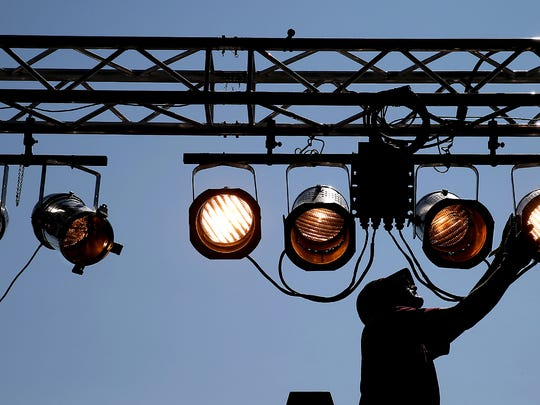 Jeff Sanders, of Gordon Sound in Silverdale, adjusts the stage lighting Tuesday at the Kitsap County Fairgrounds.
