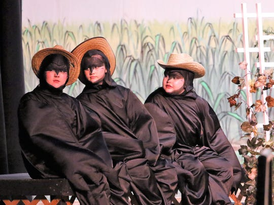 "The Crows, Caw (Maddie Grace Thierfelder), Kem (Annalise Bennett), and Another Crow (Lux Stout), sit on the fence looking for Mr. McGregor during the play, ""The Tale of Peter Rabbit and Benjamin Bunny,"" presented by the Jackson Teen Theatre March 16 at the Ned in downtown Jackson."
