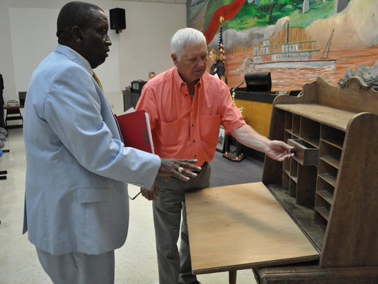 William Mixon talks to Pineville Mayor Clarence Fields about the desk his great-grandfather used.