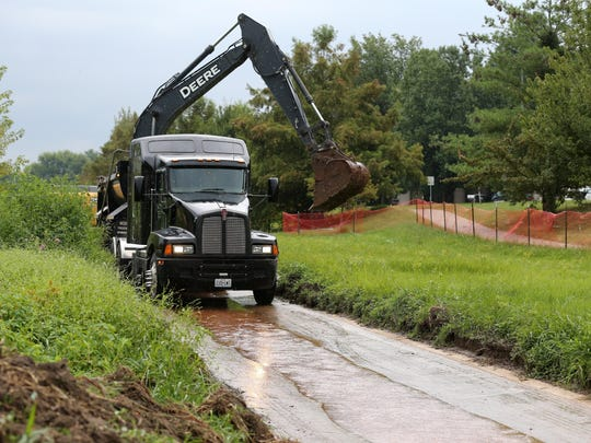 Concrete is being removed from the South Creek channel near Fort Avenue on Tuesday, September 8, 2015.