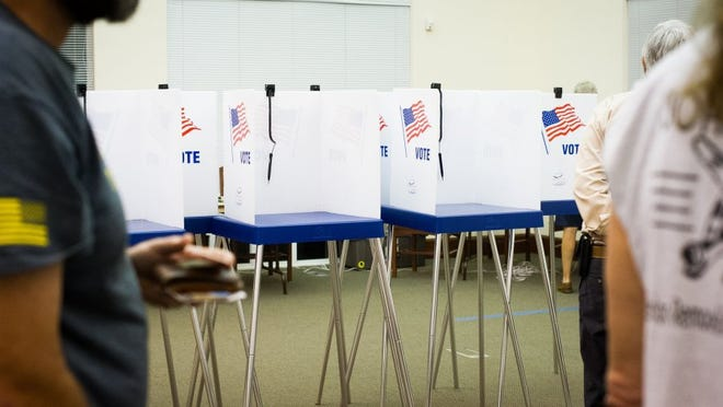 Voting booths are seen on Tuesday, March 15, 2016 at the Collier County Public Library in Naples, Fla.. (Logan Newell/Special to the Daily News)