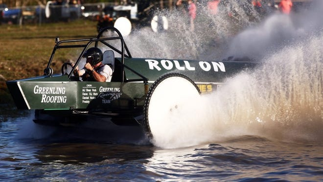 Dan Greenling finished first overall during the Budweiser Cup Winter Classic Swamp Buggy Races at the Florida Sports Park in Naples on Sunday, March 6, 2016. (Dorothy Edwards/Staff)