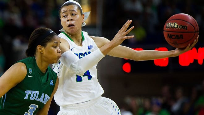 FGCU women's basketballs Whitney Knight(14) tries to get past a defender during the Sweet 16 of the Women's NIT at Alico Arena in Fort Myers, Fla. on Wednesday, March 23, 2016. (Logan Newell/Special to the Daily News)