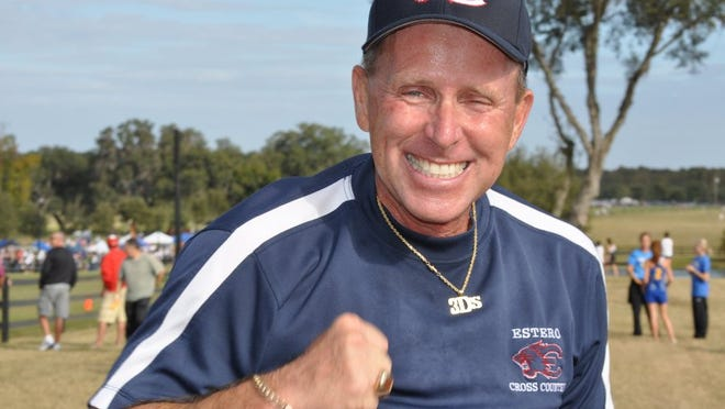 Estero cross country coach and athletic director Jeff Sommer had many reasons to smile at the state cross country meet on Nov. 20, 2010 in Dade City. Sommer's girls and boys teams both won 2A state titles and Wildcat sophomore Kacy Smith won the girls individual championship. Contributed photo