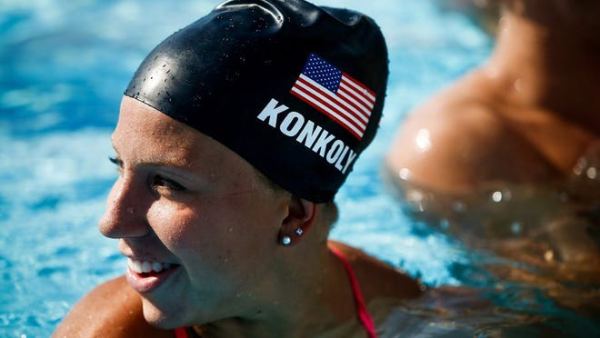 Paralympic swimmer Michelle Konkoly chats with her T2 Aquatics teammates during a break from training at the YMCA Norris Pool in Naples on Monday, August 24, 2015. Staff file photo
