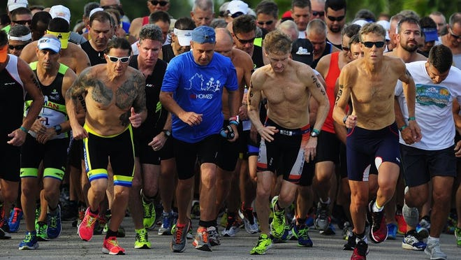 Competitors start their run during the annual Fitness Challenge Triathlon Sunday, June 5, 2016 at The Naples Beach Hotel & Golf Club in Naples, Fla. Over 600 individuals and 55 teams registered to compete in the 30th hosting of the event. Ages ranged from 13 to 85 years old. The event is known for it's 3.1-mile run, 9.3-mile bike and .25-mile Gulf of Mexico swim   œreverse   format.