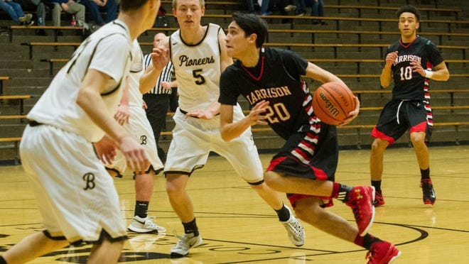 DANIEL R. PATMORE / SPECIAL TO THE COURIER & PRESS   Harrison's Robin Duncan (20) drives the ball through Boonville's Kyler Klein (11) and Glen Rouch (5) on his way to the basket in the first quarter at Boonville HS gym in Boonville, Ind. Tuesday, Jan. 5, 2016.