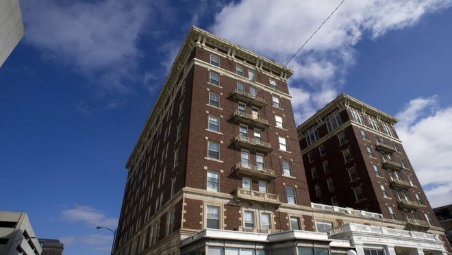 DENNY SIMMONS / COURIER & PRESS   The renovation to the outside of the old Hotel McCurdy in Downtown Evansville has already begun with a new roof, but new windows, brickwork and other renovations will begin later this spring.