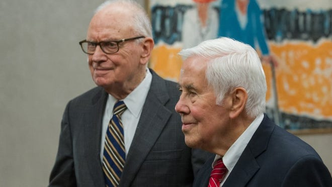 Congressman Lee Hamilton (left) and Senator Richard Lugar talk with reporters in the University Suite before going to Carter Hall for the 'Civility in American Politics' program Wednesday evening.