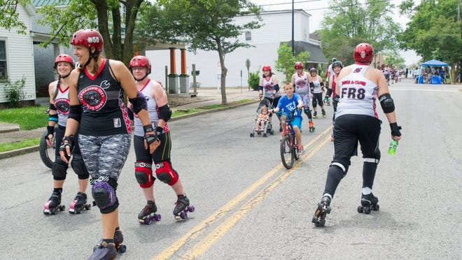 DANIEL R. PATMORE / SPECIAL TO THE COURIER & PRESS Members of the Demolition City Roller Derby team skate down North Main Street in the All Wheels Evansville parade last year as part of the Streets Alive Festival at Garvin Park in Evansville.