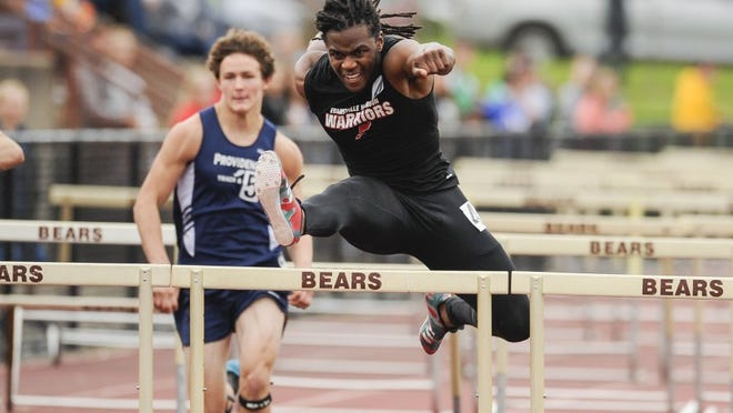 David Felton wins the 110-meter high hurdles with a time of 14.71 as he led Harrison to the team title at the boys' regional track meet on May 26, 2016.