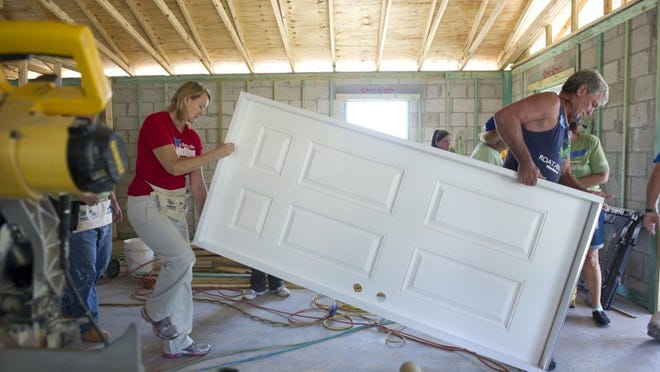 Volunteers work to constrtuct a Habitat for Humanity home in Hobe Sound in this 2015 file photo.