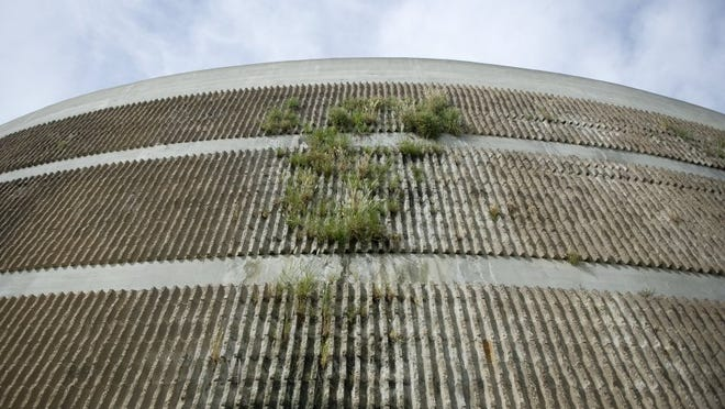Vegetation is seen growing from a biofilter tower at Oxnard's wastewater treatment facility, indicating leakage and deterioration of the plant. Under a proposed wastewater rate increase, approximately $79 million would be earmarked for capital improvements.