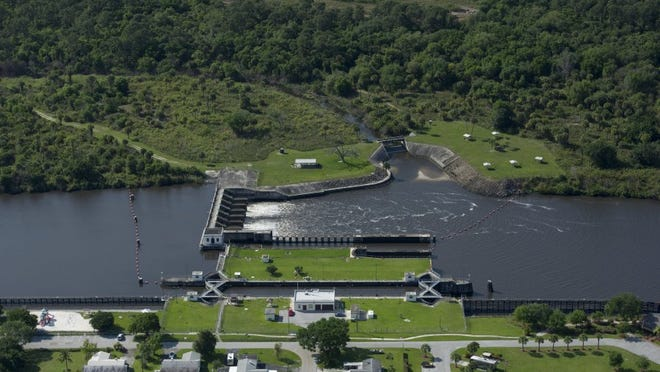 Water discharged from Lake Okeechobee flows through the St. Lucie Lock and Dam on April 4, 2016. (FILE PHOTO)