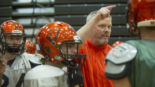 Interim coach Brent Kilpatrick directs his players in a small huddle during Cherokee football practice at Greenback School Wednesday, Nov. 18, 2015. Coach Kilpatrick has helped lead his team to the state quarterfinals for the first time since 2008. (JESSICA TEZAK/NEWS SENTINEL)