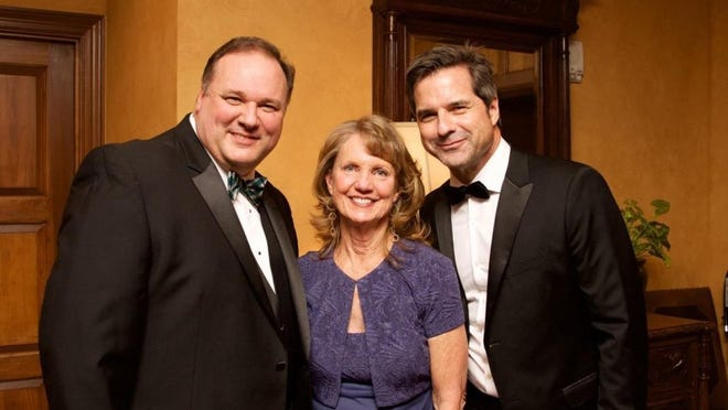 Evergreen Gala co-chairs Tim Chandler and Nancy Daves with the Travel Channel's Don Wildman.