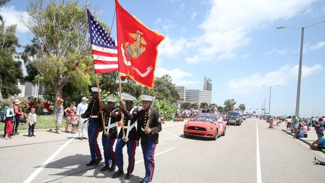 Members of Marine Corps Color Guard lead the Mayor's Big Bang Parade on North Shoreline Boulevard on Monday, July 4, 2016.