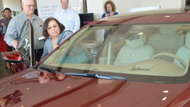 Steve and Joanna Judson look over their new Cadillac CT6 sedan at Cadillac of Knoxville on Monday shortly after the car was unveiled for them. G. CHAMBERS WILLAMS III/NEWS SENTINEL