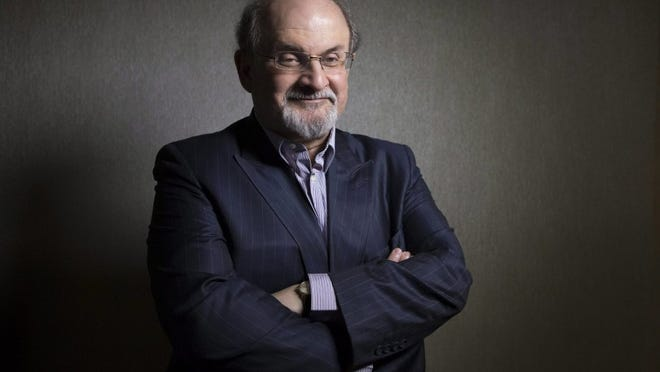 ASSOCIATED PRESS Author Salman Rushdie, shown here Sept. 8, 2012, posing during that year's Toronto International Film Festival in Toronto, doesn't believe in safe spaces against offensive ideas. That includes Emory University, where he was an instructor and some students were upset by slogans supporting Donald Trump written in chalk on campus.