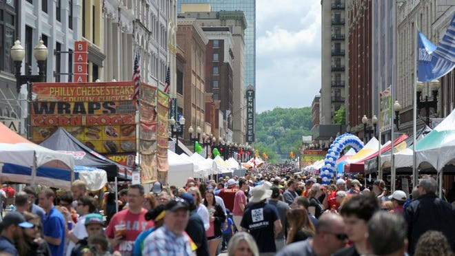 Crowds flood Gay St. during the Rossini Festival in downtown Knoxville on Saturday, April 23, 2016. (CAITIE MCMEKIN/NEWS SENTINEL)