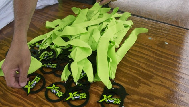 Medals wait at the finish line for participants finishing the Xtreme Air 5K inflatable obstacle course in Chilhowee Park on Saturday, April 30, 2016. (CAITIE MCMEKIN/NEWS SENTINEL)