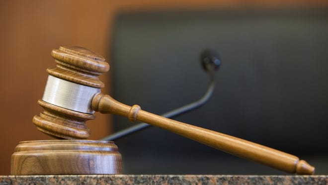 Justice gavel in courtroom.