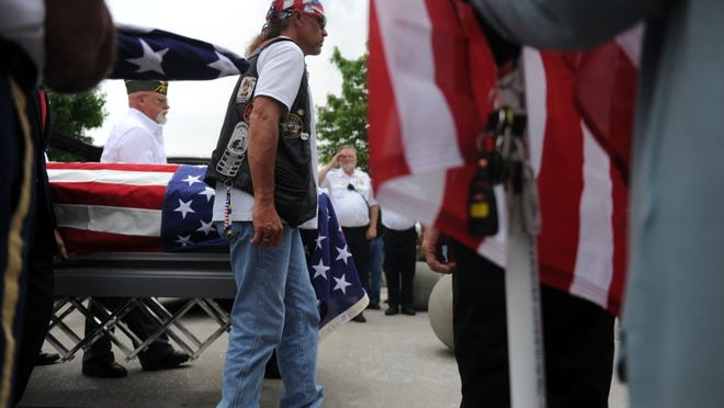 Veterans move the casket of Frank Traxler, one of six veterans from East Tennessee being honored during a memorial service at the East Tennessee Veterans Cemetery in this June 2016 file photo.