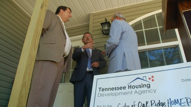 Ralph Perrey, middle, executive director of the Tennessee Housing Development Agency, talks with Oak Ridge City Manager Mark Watson, left, and Mayor Warren Gooch following a June 2016 presentation of a THDA grant of $500,000 for housing renovations in Oak Ridge.