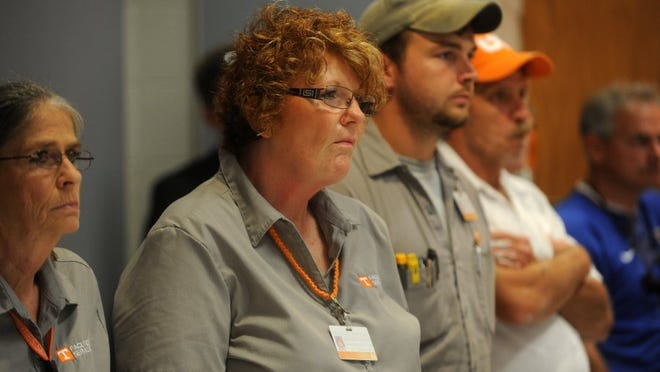 Michelle Lawson, a facilities services worker at the University of Tennessee, listens as a United Campus Workers representative comments about the outsourcing proposal during a UT Board of Trustees committee meeting at the Hollingsworth Auditorium in this file photo.