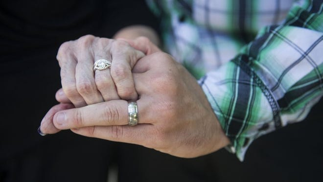 Almeda and Gary display their wedding rings.