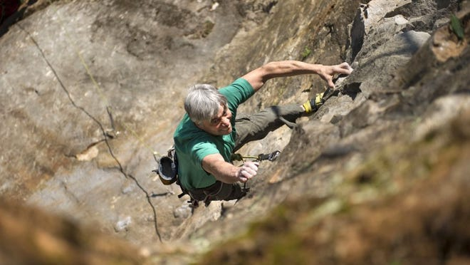 "Kelly Brown, a member of the ""Crag Committee,"" tests his skills on a bolted route called Scruffy City Blues at Ijams Nature Center's crag on March 28, 2015. Ijams has been forced to close the unique climbing area because of insurance. (PAUL EFIRD/NEWS SENTINEL)"