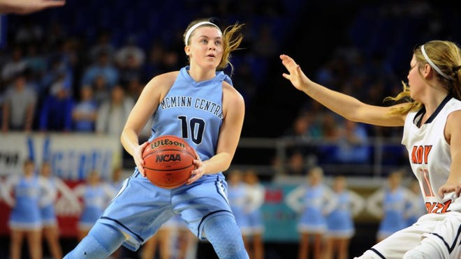 McMinn Central's Jacobi Lynn (10) locks her eyes on the basket at a quarterfinal game at the Class AA state tournament at Middle Tennessee State's Murphy Center on Thursday, March 10, 2016. McMinn Central defeated Grainger 70-58 after a tight game. (CAITIE MCMEKIN/NEWS SENTINEL)