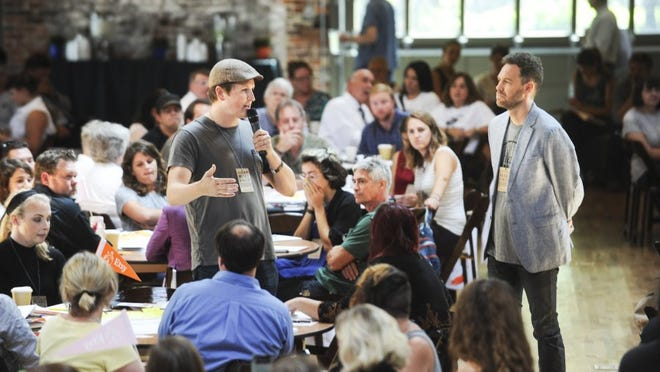 Garrett Thomson of Dogwood Arts, left, presents ideas to local entrepreneurs during the Knoxville Maker City Summit Monday, Sept. 19, 2016, at the Mill and Mine, 227 W. Depot Avenue. At right is emcee Brent Thompson of Sugarlands Distilling Co. The summit is the kick off of Innov865 Week which is aimed at connecting startup businesses with sources of expertise and capital.