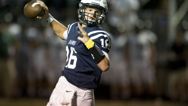 Grace Christian quarterback Luke Kirby looks for an open receiver during the game against Webb at Grace Christian Academy on Friday, September 23, 2016.