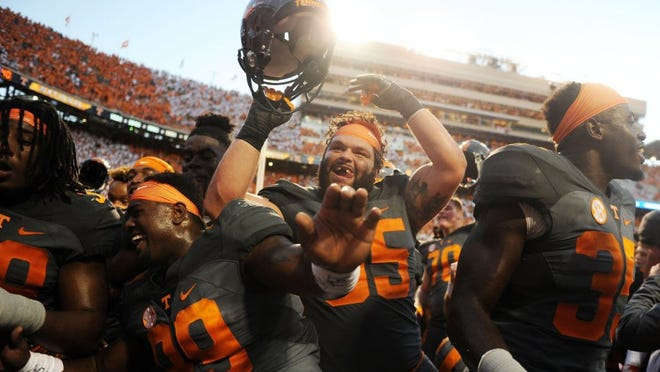 Tennessee defensive lineman Danny O'Brien (95) celebrates with teammates after defeating Florida 38-28 at Neyland Stadium on Saturday, Sept. 24, 2016.