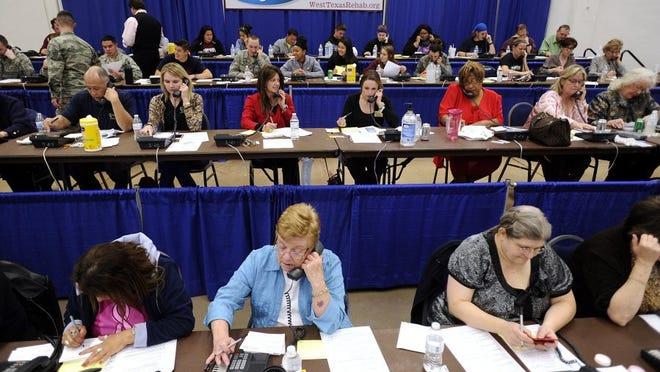 Thomas Metthe/Reporter-News Volunteers work the phones Wednesday during the first night of the West Texas Rehabilitation Center's phonathon at the Abilene Civic Center. The two-night event raises money in advance of Saturday's telethon.