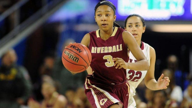 Riverdale's Anastasia Hayes (3), charges down the court as Oak Ridge's Jaymi Golden (32) follows at the state championship game at the Class AAA state tournament at Middle Tennessee State's Murphy Center on Saturday, March 12, 2016.