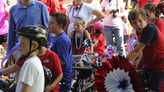 Thomas Metthe/Reporter-News Kids line up on their bike waiting for the start of the 20th annual Hillcrest Neighborhood parade on Monday, July 4, 2016.
