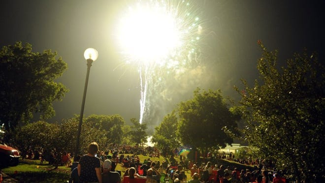 Lauren Roberts/Times Record News Thousands of people watch the fireworks at 4th in the Falls Monday, July 4th, 2016, next the Wichita River at the MPEC.
