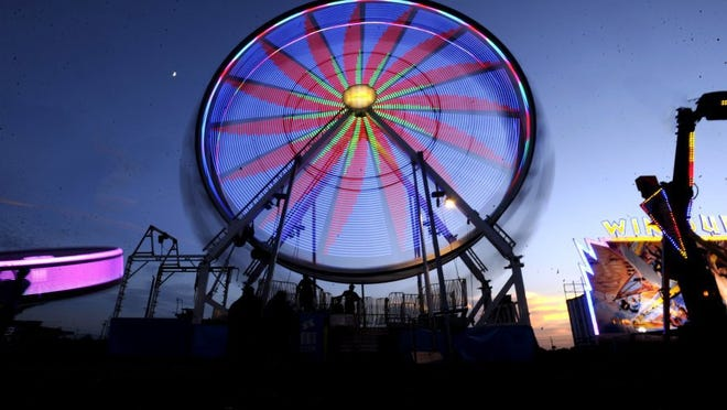 The Ferris wheel spins as the sun sets over the midway at a previous West Texas Fair & Rodeo.