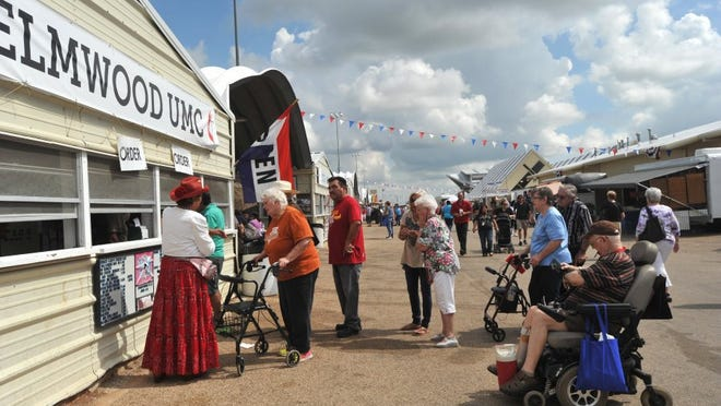 People will line up for food, including the Elmwood United Methodist Church booth at the West Texas Fair & Rodeo.