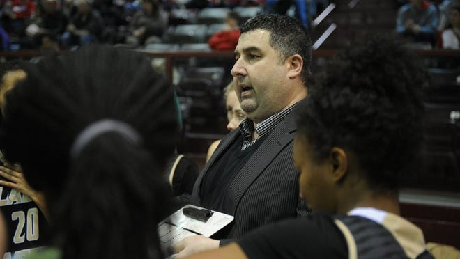 Lauren Roberts/Times Record News   Rider head girls basketball coach Ramsey Ghazal talks to his players during a timeout in the Region I-5A quarterfinal against Grapevine Tuesday, Feb. 23, 2016, in Bowie.