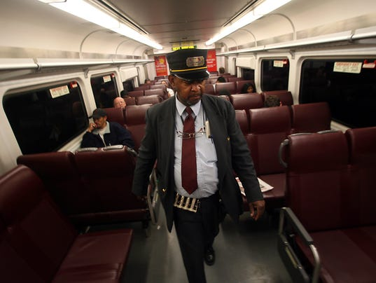 NJ Transit conductor on train