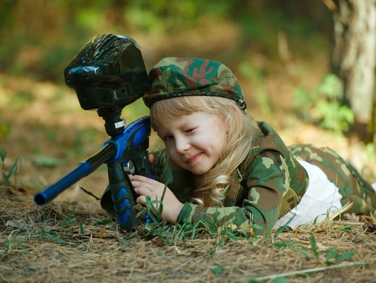 photo of little girl with rifle
