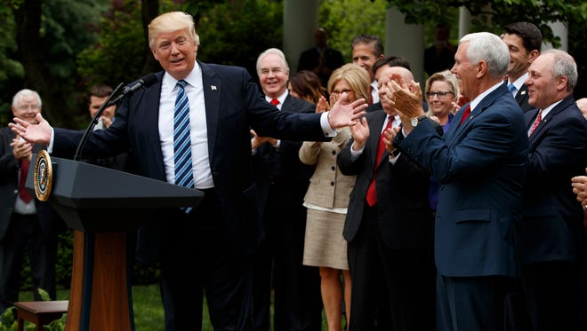 President Donald Trump, accompanied by GOP House members, speaks in the Rose Garden of the White House in Washington, Thursday, May 4, 2017, after the House pushed through a health care bill. (AP Photo/Evan Vucci)
