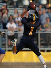 Regina's Alec Wick catches a pass during the Regals'