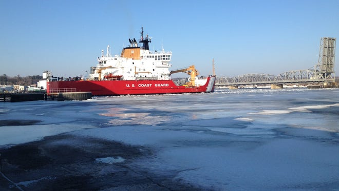 A U.S. Coast Guard cutter arrives in Sturgeon Bay to break ice in the ship canal on Tuesday morning.