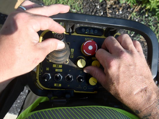 Don Young, an operator with PennDOT, uses a remote